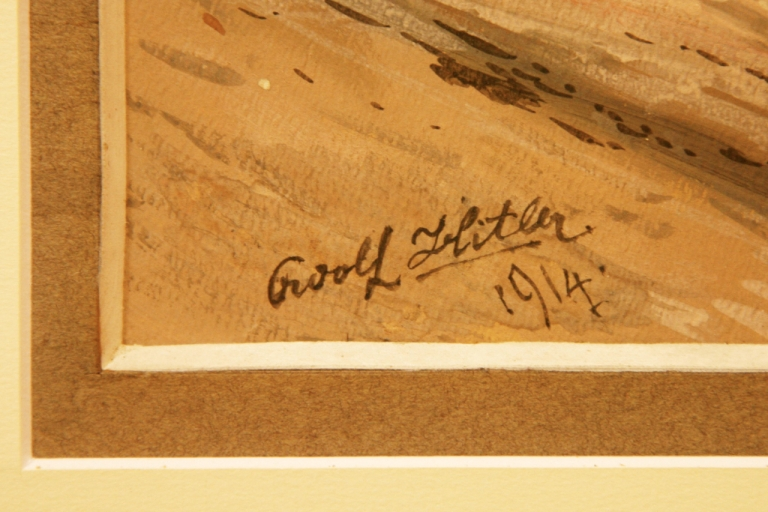 <p>The signature of Adolf Hitler on one of his paintings, entitled 'Farmstead,' before being auctioned off in the southern German city of Nuremberg in 2009.</p>