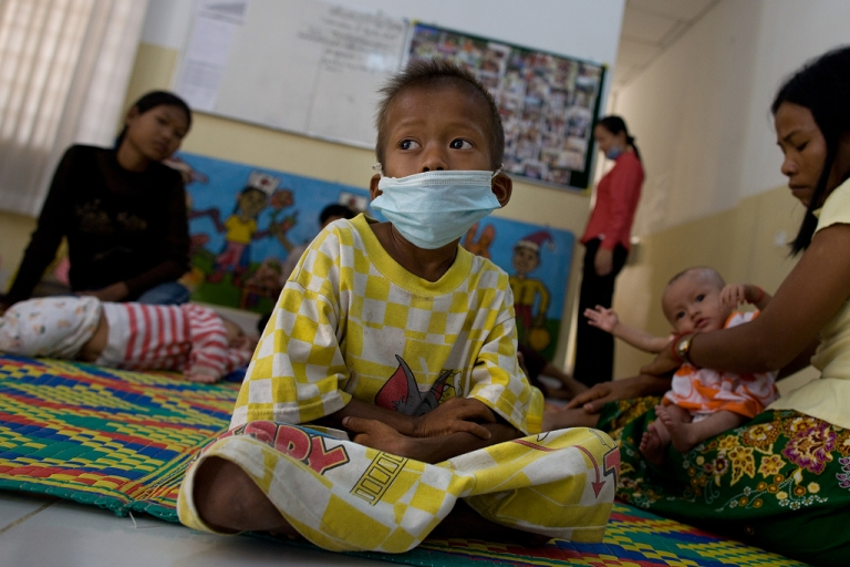 <p>Panha, 8, rests on a bed at the special ward at the National Pediatric Hospital for HIV/AIDS in Phnom Penh, Cambodia.</p>