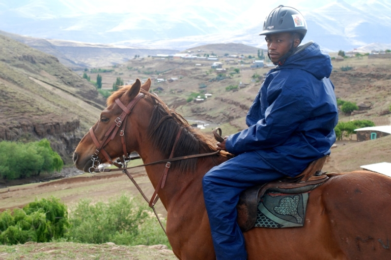 <p>Potso Seoetoe on his horse Kro-Kart delivers medicines essential to the fight against HIV/AIDS to rural clinics in mountainous Lesotho.</p>