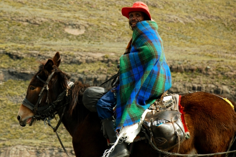 <p>A Lesotho man on horseback in the mountainous country.</p>