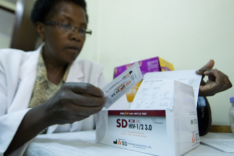 <p>A government medical worker at the National AIDS &amp; STI Control Program, NASCOP, looks on March 29, 2012 at an HIV rapid test kits that was among those recalled by the Kenyan government from its clinics earlier in the year.</p>