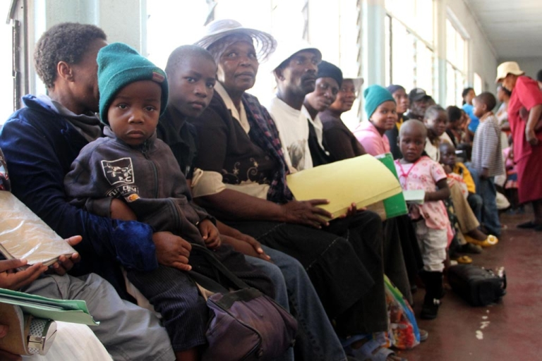 <p>Zimbabweans wait in line at Mpilo Hospital in Bulawayo to collect their monthly allocation of antiretroviral drugs (ARVs).</p>