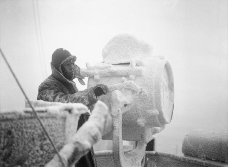 <p>Ice forming on a 20-inch signal projector on the cruiser HMS SHEFFIELD whilst she is helping to escort an Arctic convoy to Russia in December, 1941.</p>