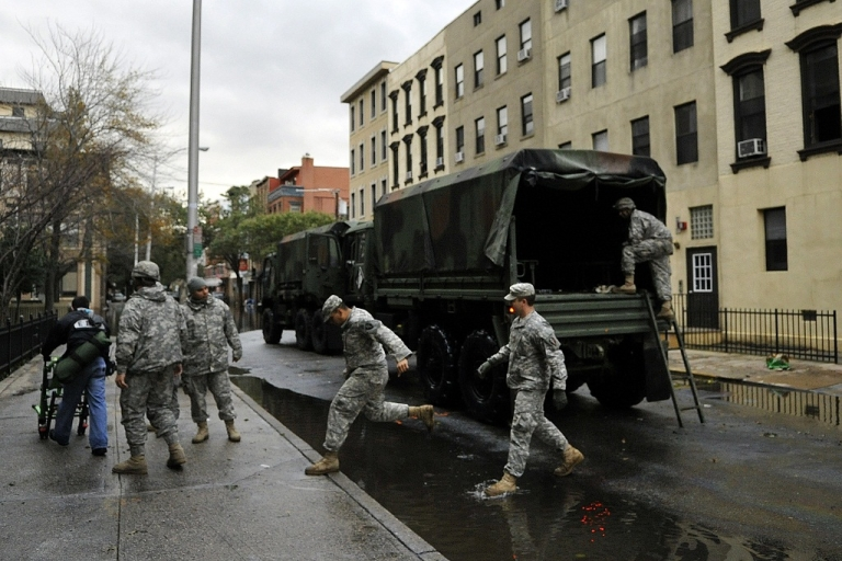 <p>Members of the Army National Guard Unit Gulf 250 from Morristown, NJ prepare to evacuate victims from Hurricane Sandy on October 31, 2012 in Hoboken, New Jersey.</p>