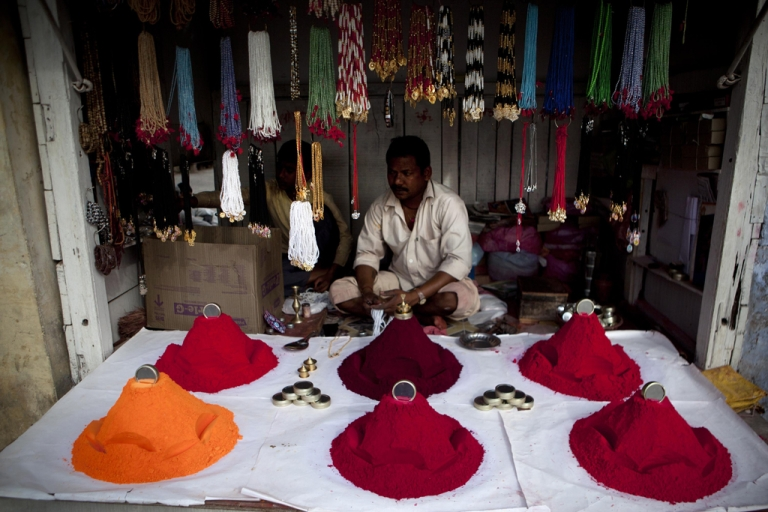 <p>A Hindu shop keeper is selling color during Holi celebrations at the Bankey Bihari Temple in Vrindavan, India. Holi is celebrated at the end of the winter season on the last full moon day of the lunar month Phalguna which usually falls in the later part of February or March. Holi, the spring festival of colours, is celebrated by Hindus around the world in an explosion of colour to mark the end of the winter.</p>