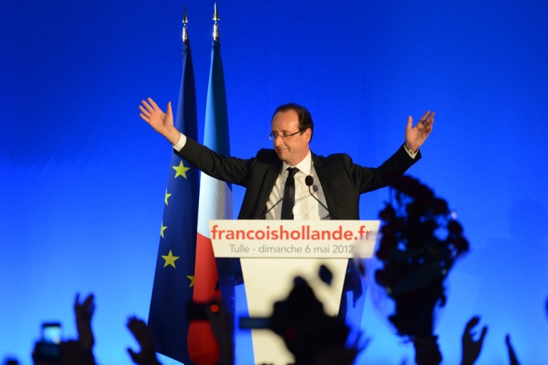 <p>Francois Hollande waves as he arrives on stage to give a victory speech after the results of the second round of the presidential election on May 6, 2012 in Tulle, southwestern France. Hollande was elected France's first Socialist president in nearly two decades today, dealing a humiliating defeat to incumbent Nicolas Sarkozy and shaking up European politics.</p>