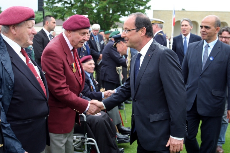 <p>French President Francois Hollande shakes hands with WWII veterans today, June 6th, at a ceremony in France for the 68th anniversary of D-Day.</p>