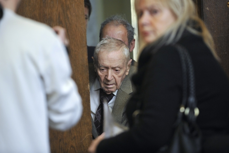 <p>Hungarian Sandor Kepiro arrives in the courtroom of Budapest Municipal Court on May 5, 2011 prior to his trial, indicted by the Simon Wiesenthal Center's information. 97-year-old Sandor Kepiro is charged with 'complicity in war crimes' in Serbia in 1942.</p>