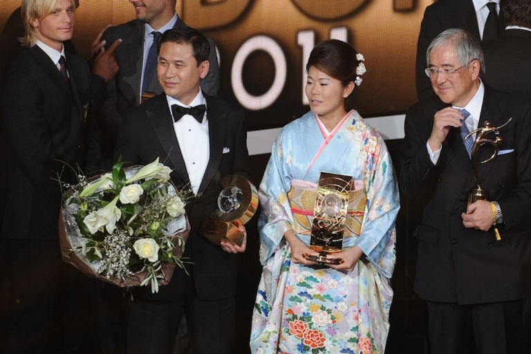 <p>Japanese footballer, Homare Sawa (C), the president of the Japanese football association Junji Ogura (R) and Japanese Womens' football team coach Norio Sasaki pose with their awards during the FIFA ballon d'or ceremony on January 9, 2012 at the Kongresshaus in Zurich.</p>