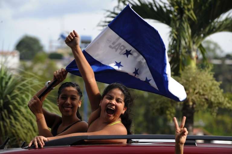 <p>Supporters of the Honduran Olympic football team celebrate their 1-0 win over Spain in the capital Tegucigalpa on July 29, 2012.</p>