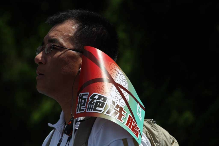 <p>A demonstrator displays a banner reading