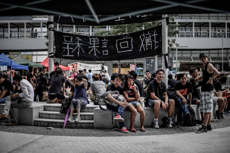 <p>Students sit in front of the Central Government Complex in Hong Kong on Sept. 4, 2012, as students and teachers protested for a sixth straight day against plans to introduce Chinese patriotism classes.</p>