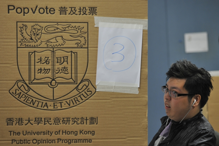 <p>A man reacts at a polling booth at a mock election for Hong Kong's chief executive at the Hong Kong Polytechnic University on March 23, 2012. Thousands of people who do not have the right to vote in the tightly controlled