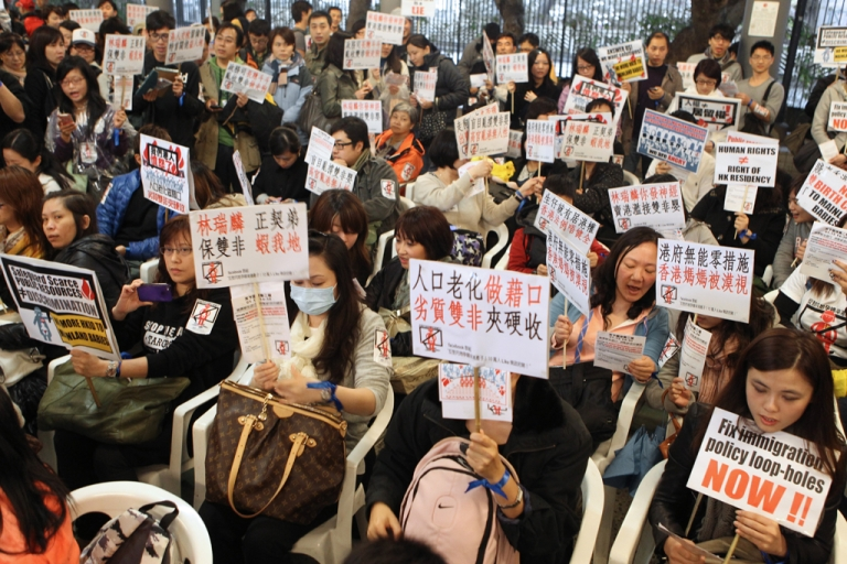 <p>Hong Kong women hold placards during a demonstration in Hong Kong on January 15, 2012. The demonstration was held to oppose the growing number of mainland Chinese women giving birth in the city.  AFP PHOTO/Joyce WOO</p>