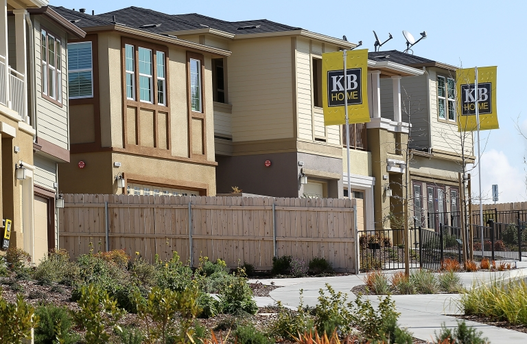 <p>Signs are posted in front of new homes at the KB Home Quarry Heights housing development on March 23, 2012 in Petaluma, Calif.</p>