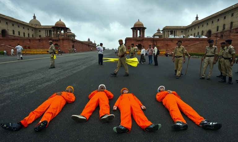 <p>Greenpeace activists dressed as coal miners lie on the ground during a protest  near Parliament in New Delhi on August 21, 2012 against alleged corruption in the allotment of coal mining blocks. A recent survey revealed that most Indians think corruption is the biggest problem facing the country, but it's not an election issue because they also think all parties are equally corrupt.</p>