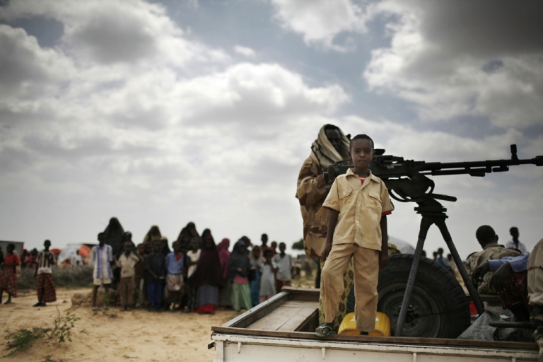 <p>A boy stands on a vehicle with Somali soldiers in Daymarudi Camp Dec. 10 2007 on the outskirts of Mogadishu.</p>