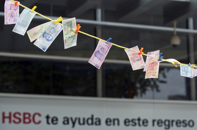 <p>Fake notes were hung out to dry during a protest in front of HSBC in Mexico City on July 30. The bank was fined for failing to apply anti-money laundering rules.</p>