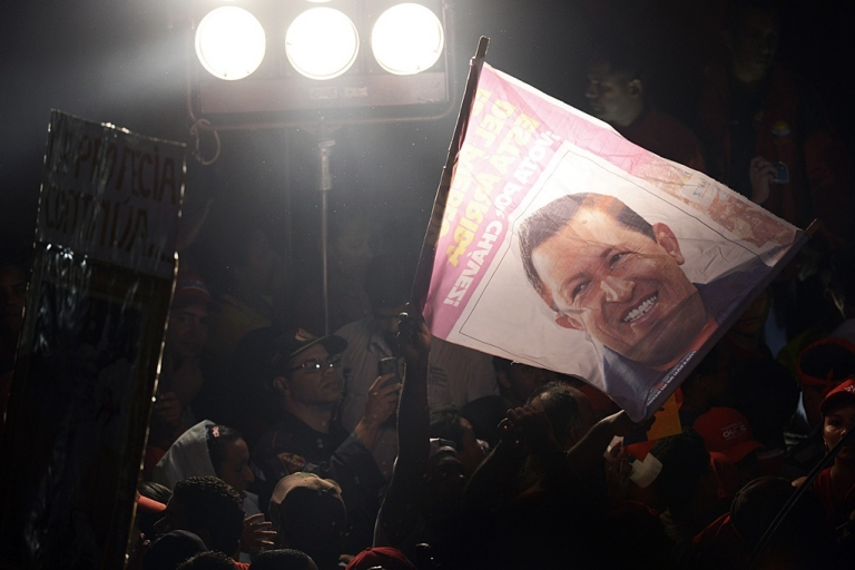 <p>Supporters of Venezuelan President Hugo Chavez celebrate after his re-election in Caracas on Oct. 7, 2012.</p>