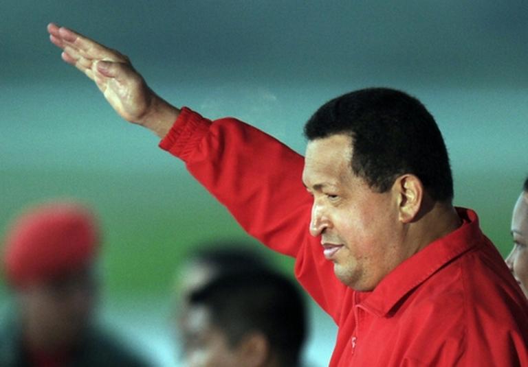 <p>Hugo Chavez salutes his people.</p>
