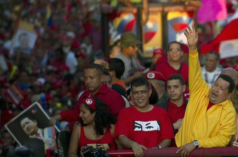 <p>Venezuelan President Hugo Chavez waves to supporters during a campaign rally in Guarenas on September 29, 2012.</p>