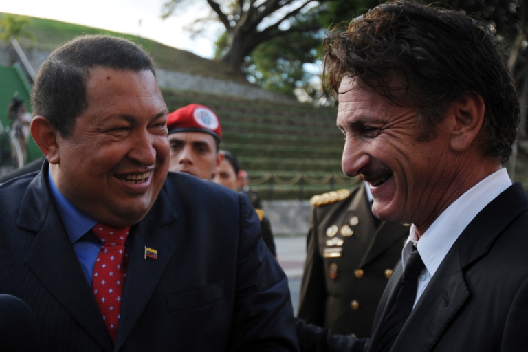 <p>Venezuelan President Hugo Chavez (L) jokes with US actor Sean Penn during his visit to Miraflores presidential palace in Caracas, on February 16, 2012. The Venezuelan government denied rumors that Chavez had to go to Cuba for emergency medical treatment after rumors began circulating about the Venezuelan leader's health.</p>