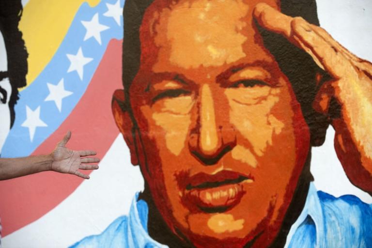 <p>A mural of Venezuelan President Hugo Chavez in Caracas.</p>