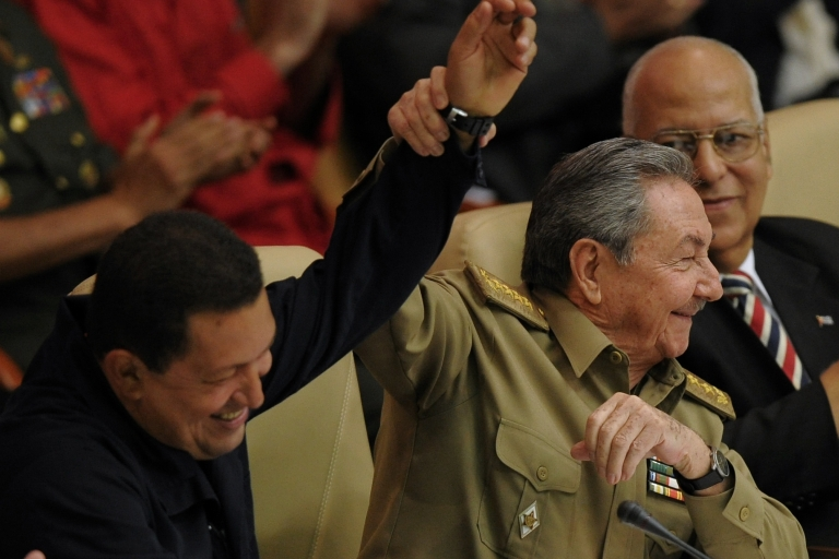 <p>Cuban President Raul Castro lifts the arm of Venezuelan President Hugo Chavez at a gathering of leftist Latin American leaders in Havana in November 2010.</p>