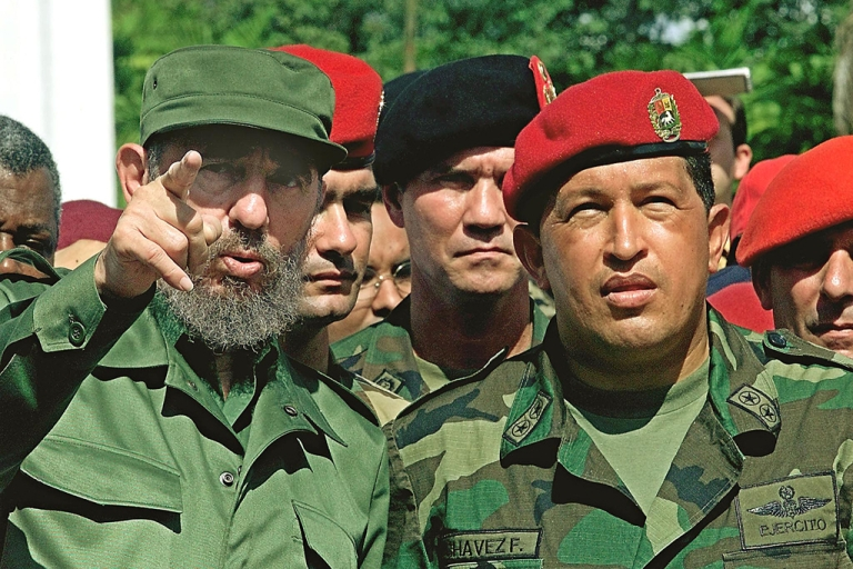 <p>Cuban President Fidel Castro (L) talks with Venezuelan President Hugo Chavez (R) during their visit to the unknown soldier monument in Campo Carabobo, Valencia, Venezuela, October 29, 2000. Castro was on a 5-day official visit to Venezuela.</p>