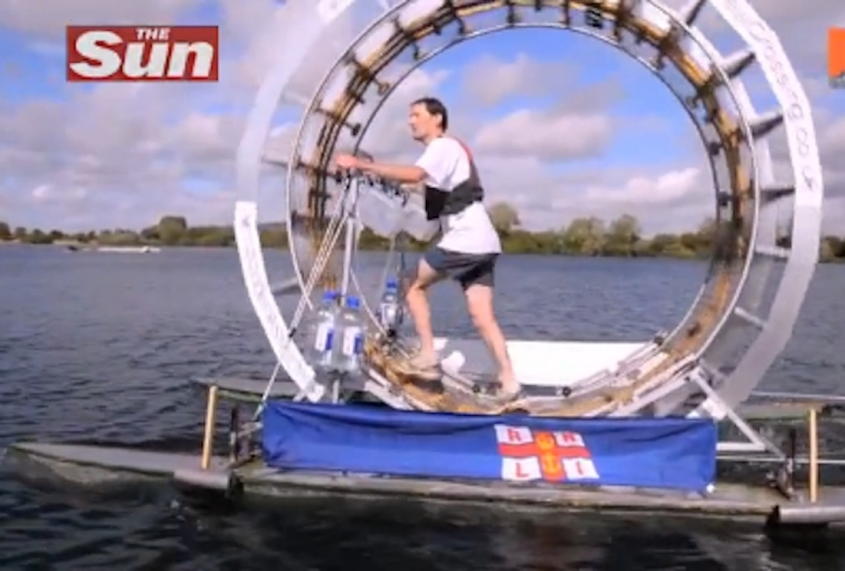 <p>Chrid Todd takes his human hamster wheel, a.k.a. the Tredalo, for a practice run.</p>