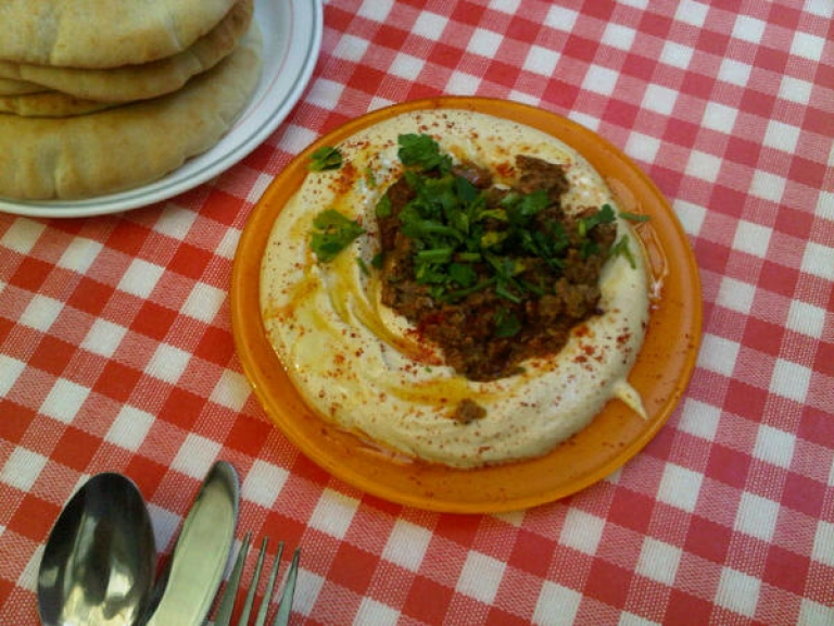 <p>GlobalPost's correspondent Noga Tarnopolsky says hummus with meat, is