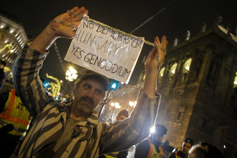 <p>An anti-government demonstrator last night in Budapest</p>