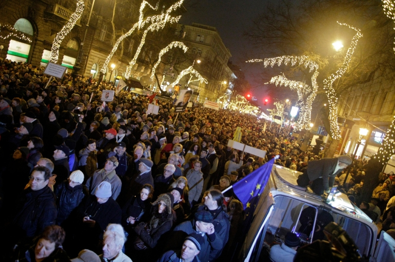 <p>Tens of thousands protested against Hungary's new constitution which critics said curbed democracy, in front of the Opera in Budapest on January 2, 2012.</p>
