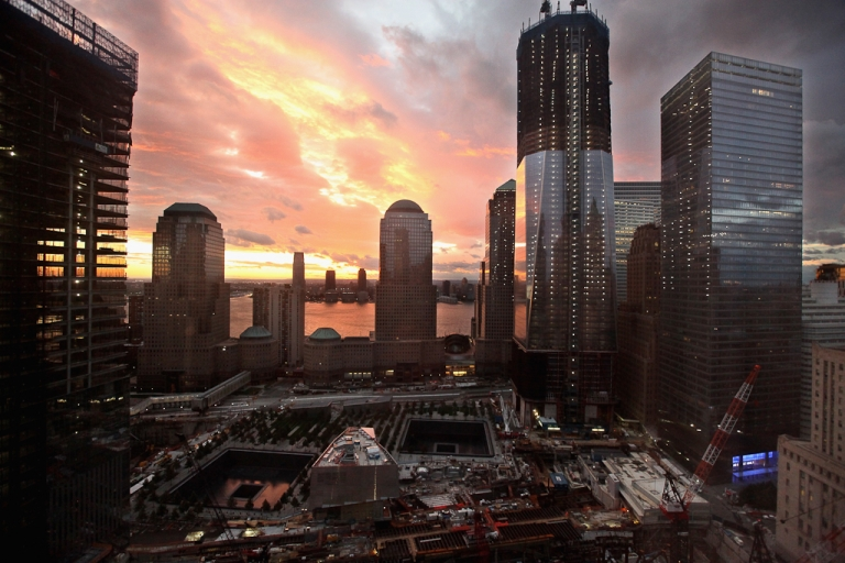 <p>The sun sets over Jersey City and the World Trade Center site, with One World Trade Center to the right on August 28, 2011 in New York City.</p>