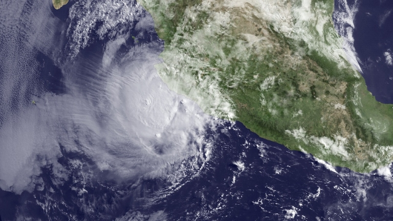<p>A satellite image taken by the US National Oceanic and Atmospheric Association shows hurricane Bud about 110 miles off the coast of Mexico on May 25, 2012.</p>
