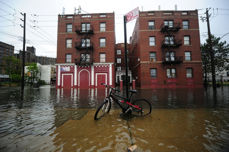 <p>A street is flooded on Coney Island after Hurricane Irene hit, in New York, August 28, 2011. Irene weakened to tropical storm status Sunday as it hit New York City, the National Hurricane Center said, but the still powerful storm was flooding parts of lower Manhattan.</p>