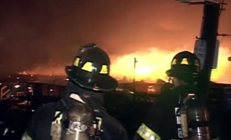 <p>A late-night blast in Indianapolis killed two people and triggered a large neighborhood fire that took firefighters hours to contain late November 10, 2012.  Here, firefights watch as a Hurricane Sandy-sparked fire destroys at least 80 homes in New York City.</p>
