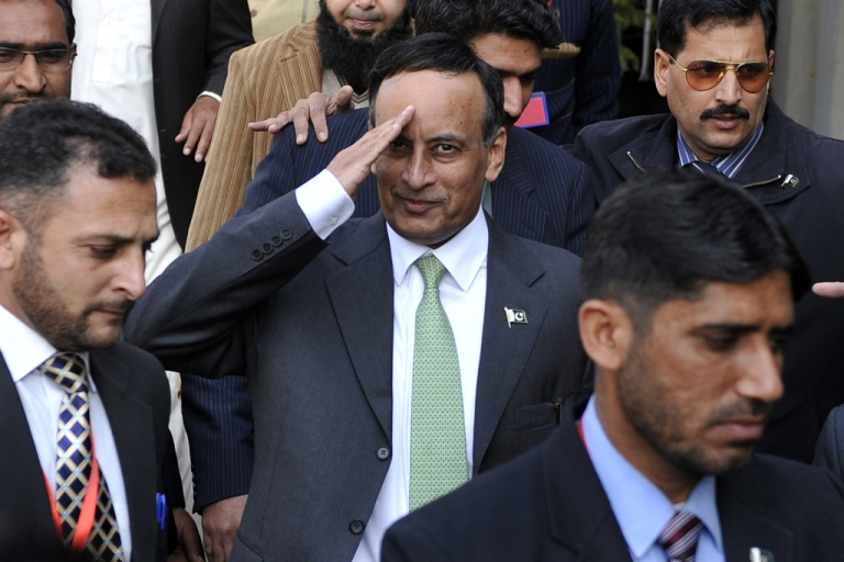 <p>Pakistan's former ambassador to United States Husain Haqqani (C) gestures as he leaves The High Court Building in Islamabad on January 9, 2012, after recording his statement before the judicial commission probing a secret memo scandal in which Haqqani allegedly approached the US authorities to prevent a possible coup d' etat by the powerful military after the secret US raid that killed Osama bin Laden in Pakistan on May 2, 2011. Haqqani, who was forced to resign last month, denied any involvement but the court has already put restrictions on him leaving Pakistan. AFP PHOTO/AAMIR QURESHI (Photo credit should read AAMIR QURESHI/AFP/Getty Images)</p>