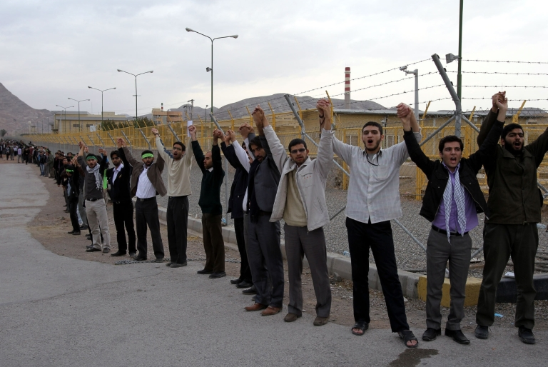 <p>Iranian students shout slogans as they form a human chain outside the Isfahan Uranium Conversion Facility during a protest in the city in support of Iran's nuclear program and against military threats by Israel on Nov. 15, 2011.</p>