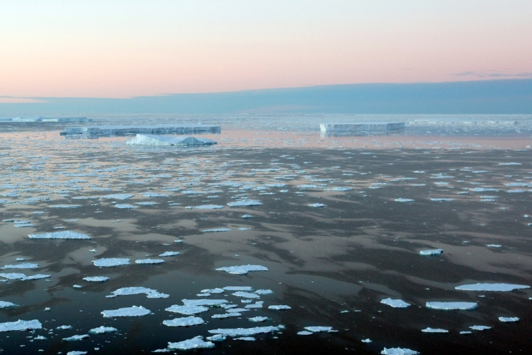 <p>Giant tabular icebergs are surrounded by ice floe drift in Vincennes Bay on January 11, 2008 in the Australian Antarctic Territory.</p>