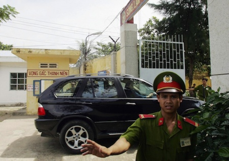 <p>VUNG TAU, VIET NAM: A policeman stops press photographers from taking pictures at Phuoc Co prison.</p>