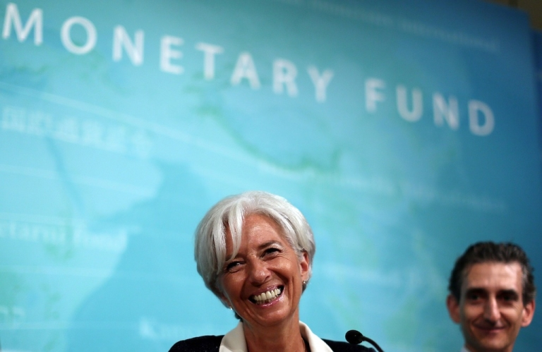 <p>IMF managing director Christine Lagarde smiles during a news conference on July 3, 2012 in Washington, DC.</p>