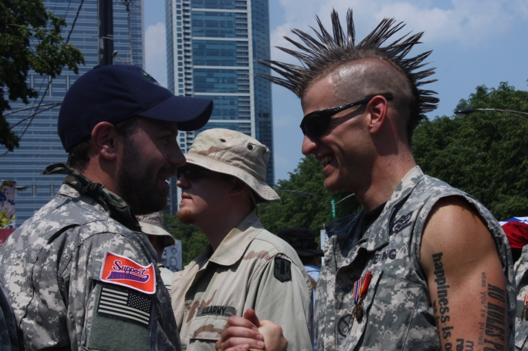 <p>Veterans in Chicago prepare to march against NATO ahead of throwing their war medals across a fence behind which world leaders were meeting.</p>