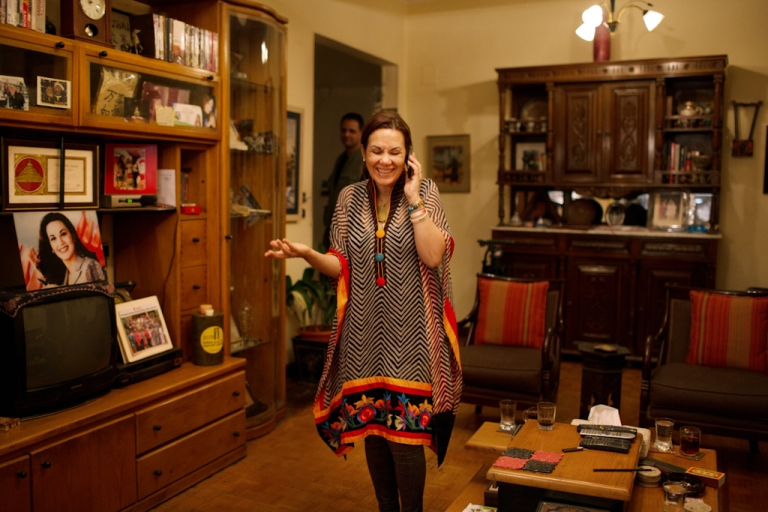 <p>Bothaina Kamel speaks on her phone at her home in downtown Cairo before leaving for TEDx Tanta, an ideas-oriented gathering held on May 19, 2012.</p>