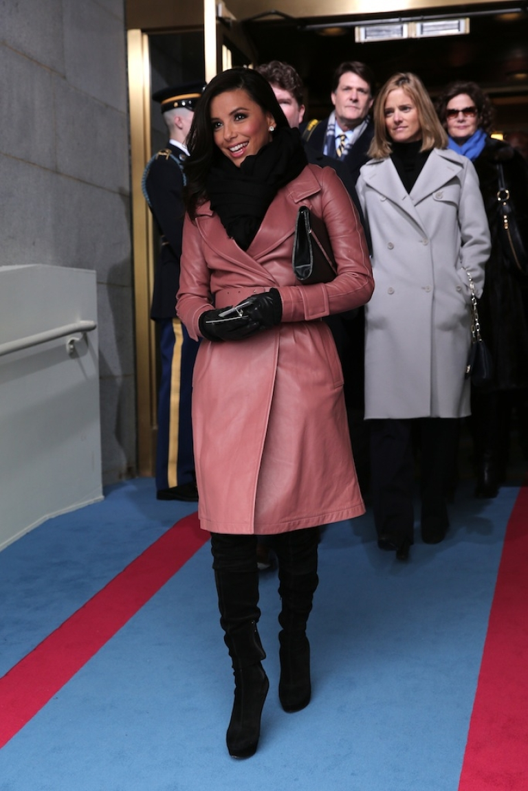 <p>Eva Longoria arrives in a leather coral trench coat with a black scarf and matching leather gloves.</p>