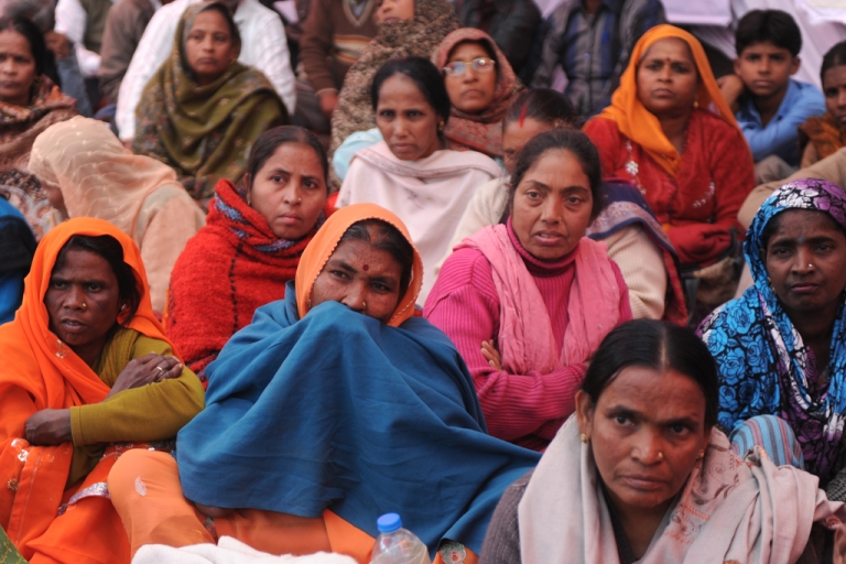 <p>Indian residents from the state of Rajasthan protesting a government plan that would transform India's corruption-ridden welfare system by replacing subsidies with direct cash transfers, New Delhi, Dec. 13, 2012.</p>