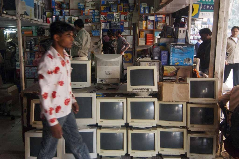 <p>An Indian man walks past old computer screens outside a shop in New Delhi's largest computer market at Nehru Place.</p>