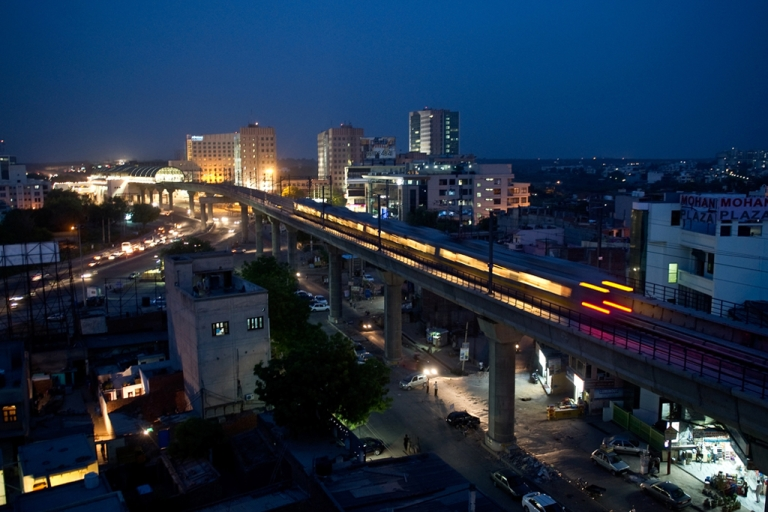 <p>Delhi Metro Rail passes through Gurgaon around 30 km south of New Delhi on June 21, 2010.</p>