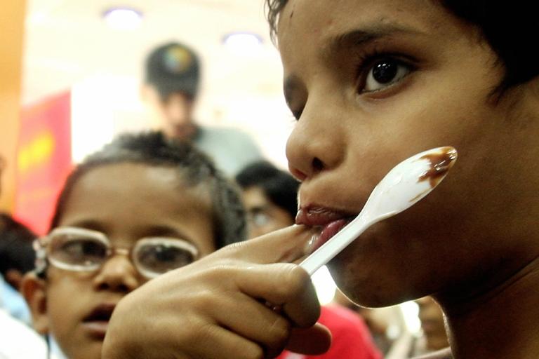 <p>Children at a McDonald's in New Delhi.</p>