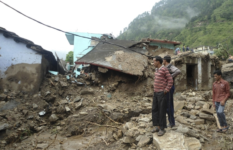 <p>Villagers look at their collapsed homes caused by landslides following heavy rains in Rudyaprayag, India's northern Uttarakhand state, on September 14, 2012. At least 45 people in northern India died on Friday in landslides and flashfloods triggered by heavy overnight monsoon rains and about a dozen others are missing, a rescue official told AFP.</p>